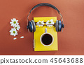 notebook, headphones and coffee on a brown wooden background 45643688