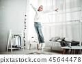 Joyful happy boy jumping in his room 45644478