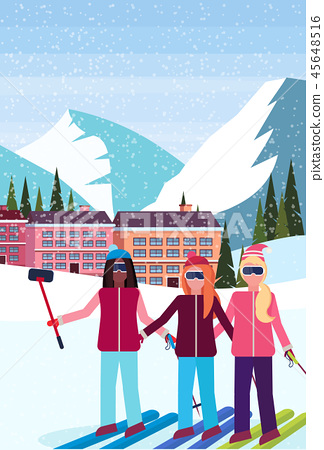 mix race women taking selfie ski resort hotel houses buildings cable car snowy mountains fir tree 45648516