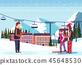 man taking photo skiers couple ski resort hotel houses buildings cable car chairlift snowy mountains 45648530