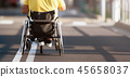 Disabled man in wheelchair on road 45658037