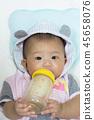 Asian cute new born baby feeding milk mother. 45658076