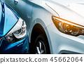 Close up headlamp light of blue and white SUV car. 45662064