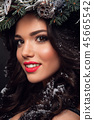 Beauty Fashion Model over Holiday. Beautiful girl with winter wreath. 45665542