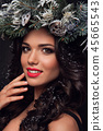 Beauty Fashion Model over Holiday. Beautiful girl with winter wreath. 45665543