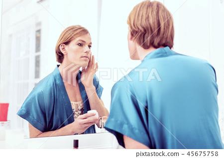Beautiful young crossdresser in blue bathrobe staying in bathroom 45675758