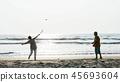 Active senior couple playing tai chi ballon ball at the beach. 45693604