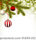 Christmas greeting card with pine branches, balls. 45694192