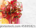 Christmas gifts decorated in green and red paper 45695821