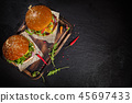 Delicious hamburgers, served on stone. 45697433