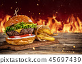 Delicious hamburger with fire on background 45697439