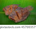 Fried fish isolated on banana leaf background. 45700357