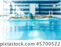 Photo of sporty man sailing down path in pool in training 45700522
