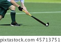 Field Hockey player passing  ball to a team mate. 45713751