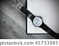 Notepad and watches on the texture.background  45733065