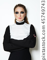 Fashion model in blouse with oversized sleeves 45749743
