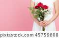 Woman in a white dress with a bouquet of roses: red rose bouquet and a girl 45759608
