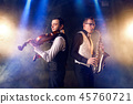 Saxophonist and violinist playing classical music 45760721