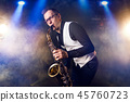 Male saxophonist playing classical music on sax 45760723