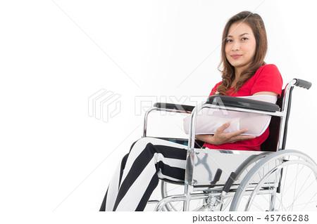 Broken arm woman on wheelchair isolate. 45766288