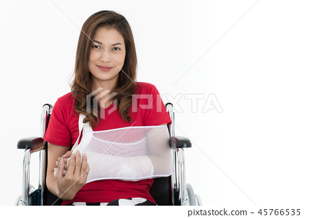 Broken arm woman on wheelchair isolate. 45766535