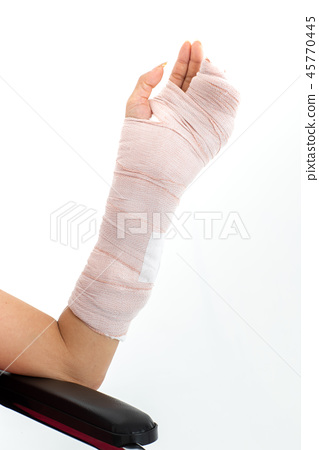 Broken arm isolated in white. 45770445