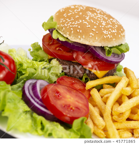 Burger with French fries cutlet with cheese and tomato 45771865