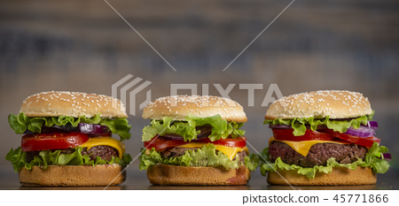 Burger with French fries cutlet with cheese and tomato 45771866