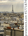 The roofs of Paris and its chimneys under a clouds sky 45771874