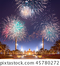 Beautiful fireworks above Sheikh Zayed Grand Mosque at sunset Abu-Dhabi, UAE 45780272