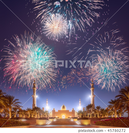 Beautiful fireworks above Sheikh Zayed Grand Mosque at sunset Abu-Dhabi, UAE 45780272