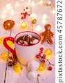 Christmas cup with hot chocolate and whipped cream. 45787672