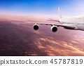 Big airplane flying above dramatic clouds. 45787819