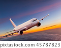 Commercial airplane flying above dramatic clouds. 45787823
