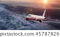 Commercial airplane flying above dramatic clouds. 45787826