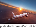 Commercial airplane flying above dramatic clouds. 45787832