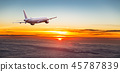 Commercial airplane flying above dramatic clouds. 45787839