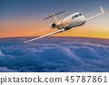 Private jet plane flying above dramatic clouds. 45787861