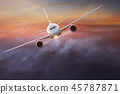 Commercial airplane flying above dramatic clouds. 45787871