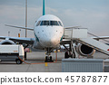 Front view of commercial jet plane on the runway. 45787877