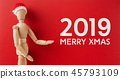 wooden santa claus mannequin hold empty red board 45793109