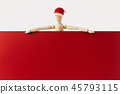wooden santa claus mannequin hold empty red board 45793115