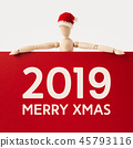 wooden santa claus mannequin hold empty red board 45793116