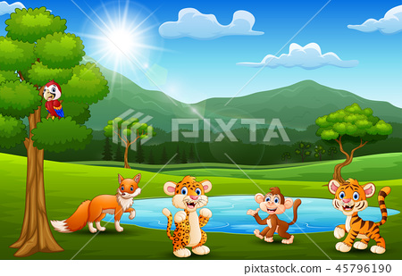 Happy animals playing next to small ponds with mou 45796190