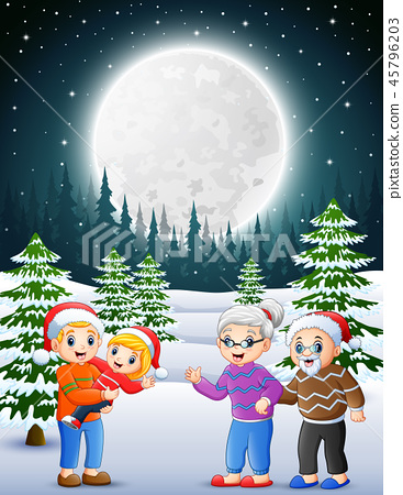 Happy familly in the snowy garden at night 45796203