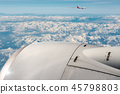 Commercial Airplanes Flying above the Clouds 45798803