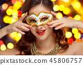 Beauty model woman wearing venetian masquerade carnival mask at party 45806757