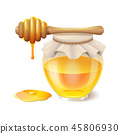 Tasty honey in glass jar with honey dipper 45806930