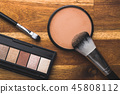 The makeup powder and brush. Make-up accessories. 45808112