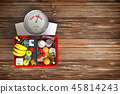 Groceries in a shopping basket on weight scale 45814243